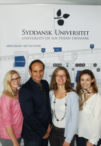 Gary Lovatt pictured with members of the University of Southern Denmark; researcher Birthe Marie Rasmussen, Associate Professor Christiane Stock and Associate Professor and Head of Studies Lotte Valentin-Holbech